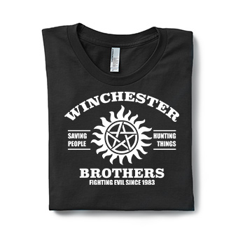 Image of a folded black classic t-shirt with a custom printed Supernatural Winchester Brothers design printed on the front.