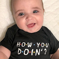Happy and cute infant in a Friends TV Series onesie from Cafepress