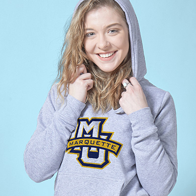 College student wearing her officially licensed Collegiate hooded sweatshirt from CafePress.
