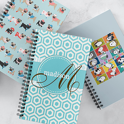 Assortment of notebooks, perfect for the start of a new school year.