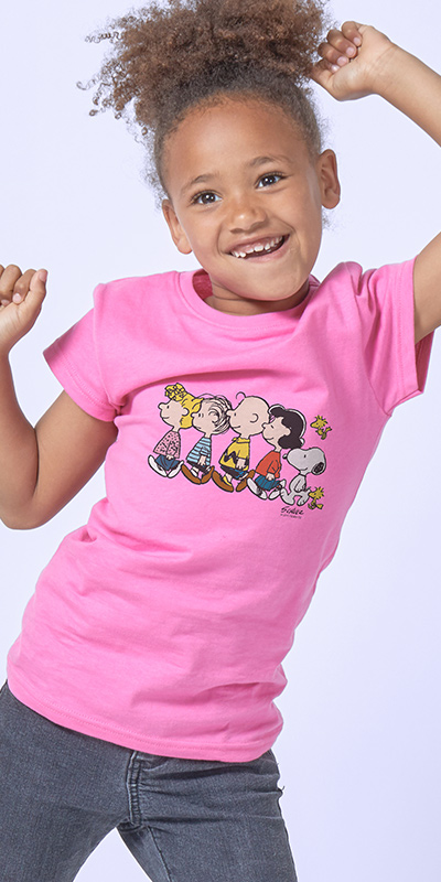 Smiling African American young girl dancing in her new officially licensed Peanuts CafePress shirt.