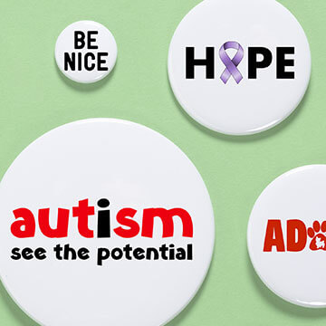 Multiple button sizes showing support for various causes including autism awareness, women, pets, adoption, cancer and more