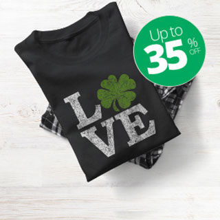 Black t-shirt with black plaid pajama pants with design reading LOVE where the O is a clover