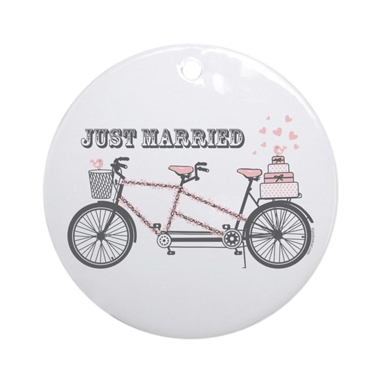 White ornament with cute illustration of bicycle with cake on the end and text that reads Just Married