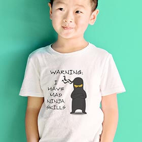 Young kid standing happily in his customized funny Cafepress T-Shirt