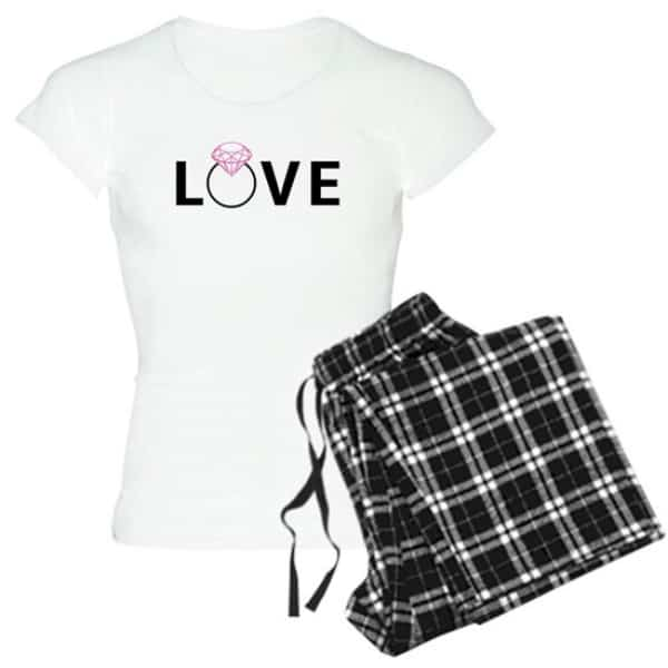 Pajama set with black plaid pattern pants and white t-shirt with custom design of the word LOVE with a diamond ring making the shape of the O.