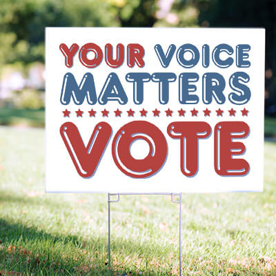 Image of an election 2020 political yard sign in a neighborhood with a custom designed and printed message that reads: Your Voice Matters: Vote.