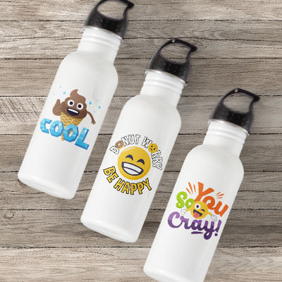 Image of three water bottles lying on a Summer outdoor deck with custom licensed emoji designs printed on the front.