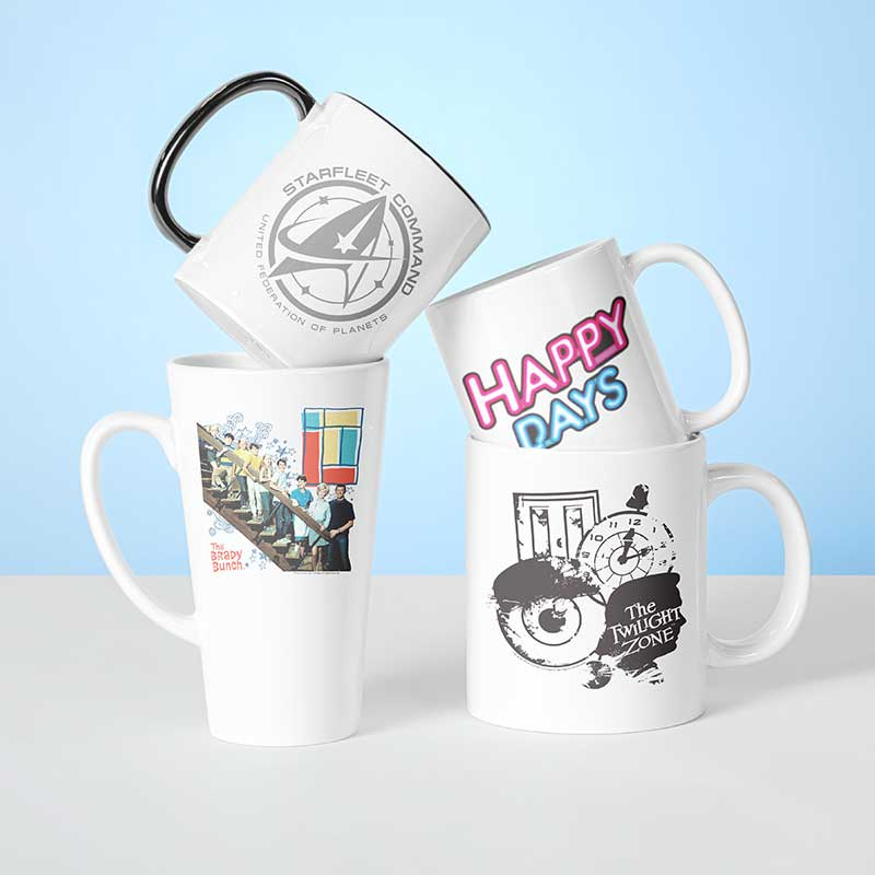 4 custom printed various shape and size coffee mugs printed with entertainment icon designs from CBS TV Show anniversaries. Happy Days, Twilight Zone, Brady Bunch and Star Trek.