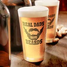 Drinking glasses filled with beer with funny saying printed on them. Great idea for a Father's Day gift.