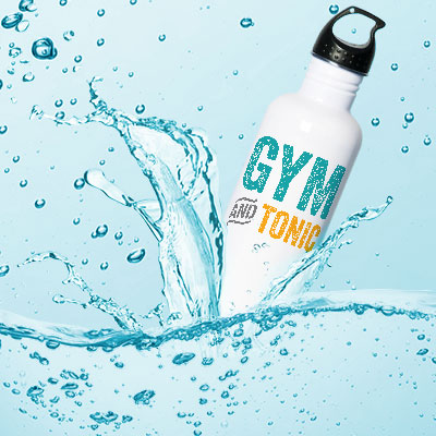 Image of a water bottle splashing into clear blue water. The water bottle has a funny custom design printed on the front that reads: Gym and Tonic.