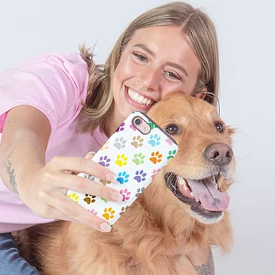 A dog and his owner taking a selfie with a custom printed phone case
