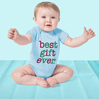 Baby girl wearing a blue baby bodysuit onesie gift with a Best Gift Ever design