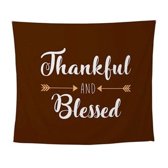 Custom printed tapestry with a design that reads: Thankful and Blessed.