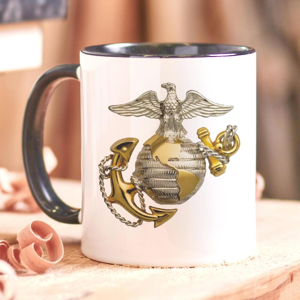 Black handle coffee mug sitting on a workbench with official U.S. Marine Corps insignia