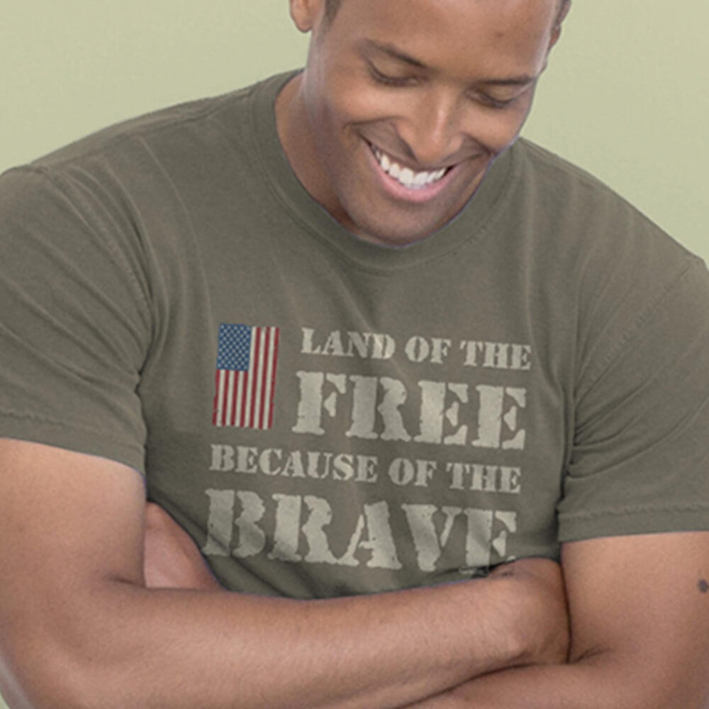 African American man wearing Land of the Free Because of the Brave t-shirt design
